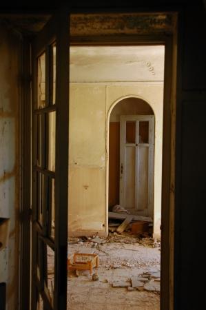 ramshackle: Doors and broken floor tiles in abandoned decayed house interior.