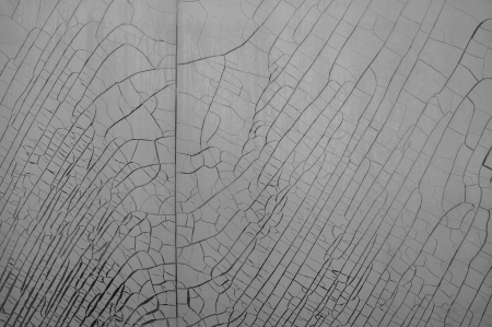 Cracked and weathered plastic window insulation film shrink abstract background. Stock Photo
