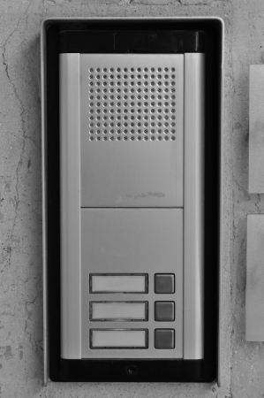 intercommunication: Doorphone intercom doorbell with buttons and speaker. Black and white.
