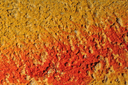 Red paint smudged on yellow textured wall background. Stock Photo - 22547998