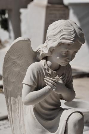 Praying angel marble funerary statue. Mourning cherub abstract. 스톡 콘텐츠