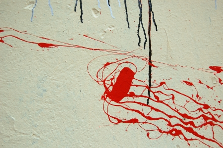 Red color splashed on white textured wall. Dripping paint abstract background. Stock Photo - 24197731