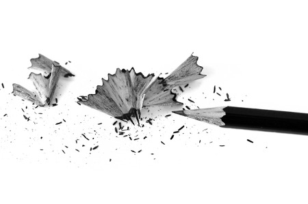 Sharpened pencil and shavings background. Black and white.