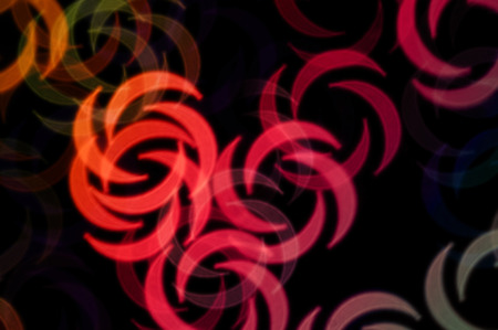 Abstract swirl shapes colorful orbs blur party background. photo