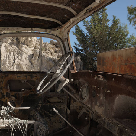 Rusty dashboard in abandoned antique car interior. photo