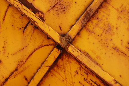 Rusty yellow metal weathered and worn abstract background texture  photo