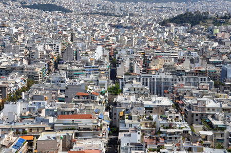 urbanized: ATHENS, GREECE - APRIL 20, 2014: Apartment buildings aerial view densely populated eastern suburbs of the city of Athens, Greece.