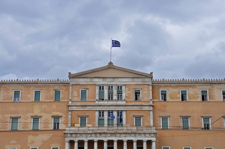 hellenic: Hellenic parliament neoclassical building facade under cloudy sky  Athens, Greece