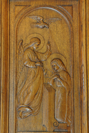 wood carving door: Annunciation of Virgin Mary religious scene carved on antique wooden door from 1927