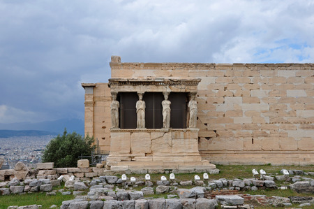 caryatids: Porch of the Caryatids exterior view of Erechtheion ancient temple ruins at the Acropolis, Athens Greece  Stock Photo