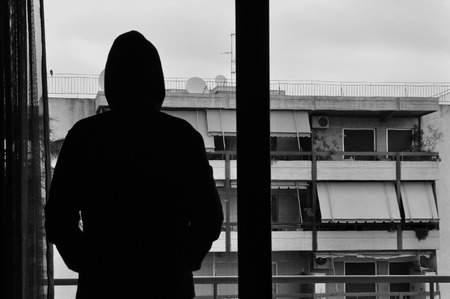 Man looking at city view through window abstract silhouette  Black and white  photo