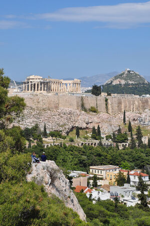 ATHENS, GREECE - APRIL 20, 2014  View of the Acropolis and Odeon of Herodes Atticus from Philopappos hill