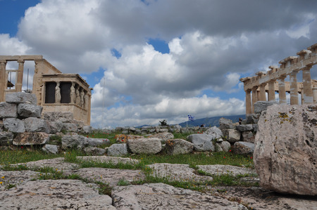 caryatids: ATHENS, GREECE - MAY 6, 2014  View of Parthenon and Erechtheion with the Porch of Caryatids at the Acropolis of Athens, Greece