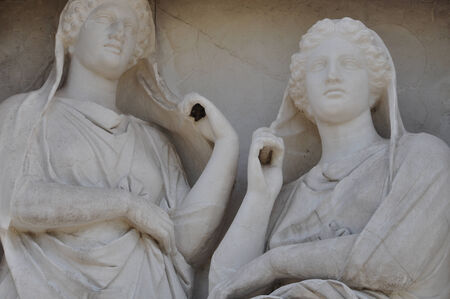 transcendence: Stele of Demetria and Pamphile funerary sculpture in memory of two dead sisters depicted gazing apathetically and grasping their veils. Ancient cemetery of Kerameikos, Athens Greece.