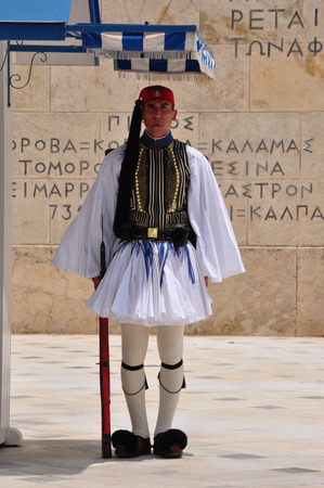 tsolias: ATHENS, GREECE - JUNE 9, 2014: Evzone soldier with traditional uniform standing guard at the Tomb of the Unknown Soldier in Athens, Greece.