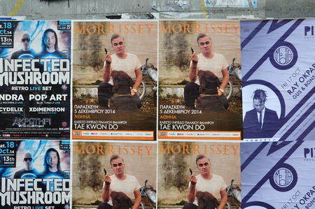 psy: ATHENS, GREECE - OCTOBER 15, 2014: Wall with live music concert posters indie rock by Morrissey and dj sets of minimal techno by Ray Okpara and psychedelic trance by Infected Mushroom. Editorial