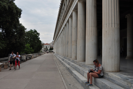 ATHENS, GREECE - SEPTEMBER 2, 2014: People at stoa of attalos in the ancient agora.