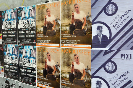 psy: ATHENS, GREECE - OCTOBER 15, 2014: Wall plastered with live music concert posters indie rock by Morrissey and dj sets of minimal techno by Ray Okpara and psychedelic trance by Infected Mushroom. Editorial