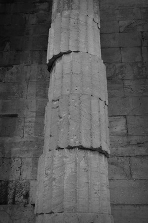 unstable: Unstable ancient greek column. Marble pillar unbalanced structure black and white.