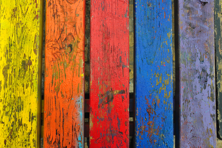 Chipped paint wood texture colorful planks weathered wooden boards abstract background. photo