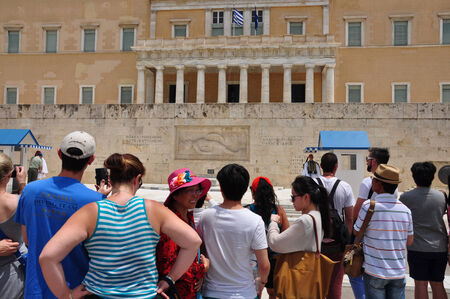 tsolias: ATHENS, GREECE - JUNE 9, 2014: Crowd of people watch the inspection of the evzone soldiers guarding the tomb of the unknown soldier. Hellenic parliament, Athens Greece. Editorial
