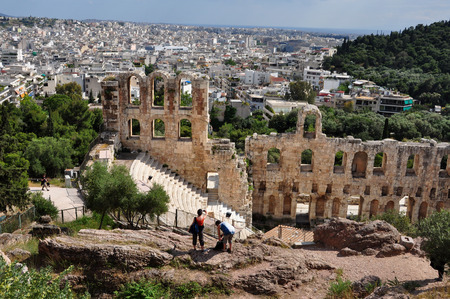 ATHENS, GREECE - MAY 6, 2014: People taking pictures at Odeon of Herodes Atticus an ancient theatre under the Acropolis of Athens, Greece.
