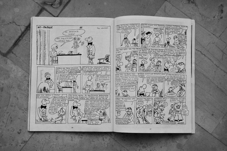 satirical: ATHENS, GREECE - JANUARY 7, 2015: Comic book by cartoonist and writer Georges Wolinski (1934 - 2015) a victim of the terrorist attack at the office of Charlie Hebdo satirical magazine on January 7, 2015 in Paris, France.