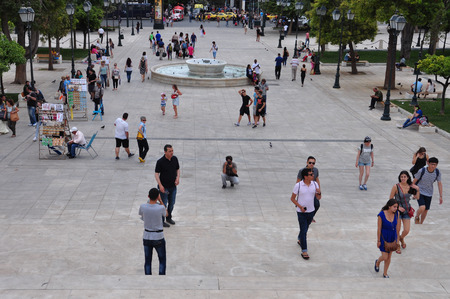 syntagma: ATHENS, GREECE - JUNE 9, 2014: Lottery vendors and people walking at Syntagma square in downtown Athens, Greece.