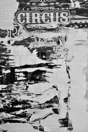grunge layer: Layers of torn billboard posters abstract rough background texture. Black and white. Stock Photo