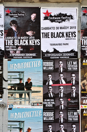 williams: ATHENS, GREECE - JANUARY 16, 2015: City wall covered with concert posters for upcoming live music shows by The Black Keys, Raveonettes and Robbie Williams. Editorial