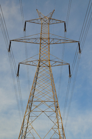 electricity pylon: Transmission tower electricity pylon steel industrial structure and power lines.