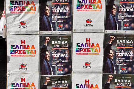 prime minister: ATHENS, GREECE - JANUARY 28, 2015: Political campaign posters for Syriza - Coalition of the Radical Left winner of the January 25, 2015 greek national elections. Portrait of Alexis Tsipras prime minister of Greece and slogan which reads Hope is coming