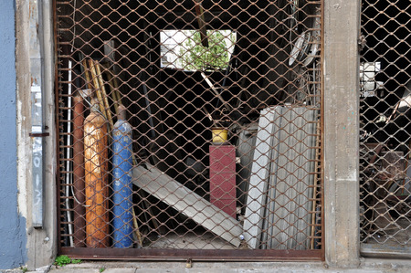 mesothelioma: Abandoned shop that sold asbestos products and fibrocement roofings with stock still inside. Hazardous banned toxic material.