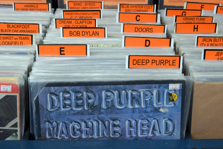 alphabetical order: ATHENS GREECE  APRIL 27 2015: Vintage rock music vinyl records for sale archived in alphabetical order and album sleeve for Machine Head by Deep Purple released in 1972. Editorial