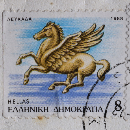 postmarked: GREECE  CIRCA 1988: Pegasus flying horse greek mythology winged creature illustration on vintage postage stamp printed and postmarked by the Hellenic Post.