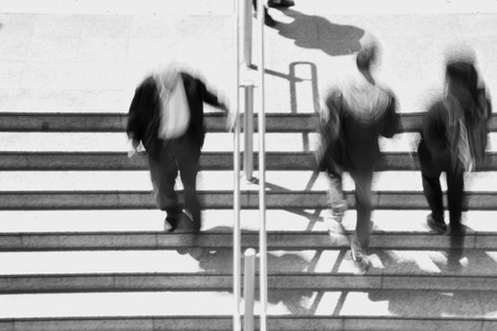 blur subway: People on subway station stairway abstract motion blur. Black and white.
