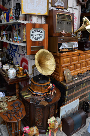 ATHENS GREECE  APRIL 24 2015: Vintage objects and furniture for sale at street market antiques shop.