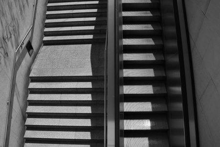 handrail: Staircase steps with handrail and escalator. Black and white. Stock Photo