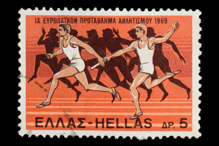 postage: GREECE  CIRCA 1969: Relay race illustration with modern runners and ancient athletes silhouette on Hellenic Post Office vintage postage stamp for the 1969 European Athletics Championships held in Athens Greece.