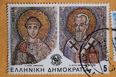GREECE  CIRCA 1985: Saints Demetrius and Methodius of Thessaloniki detail from byzantine era mosaic on vintage postage stamp printed by the Hellenic Post.