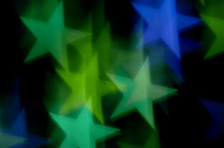 blue background abstract: Blue and green stars bokeh abstract motion blur. Colorful background. Stock Photo