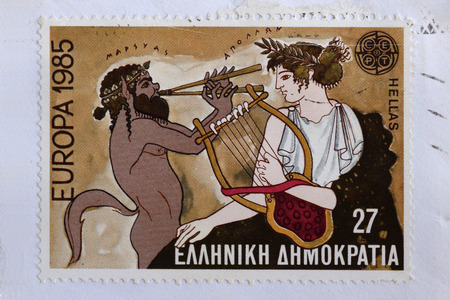 postage: GREECE  CIRCA 1985: Marsyas greek mythology satyr plays aulos double flute on music challenge that cost him his life against Apollo ancient god of music and the arts. Illustration on vintage postage stamp printed by the Hellenic Post. Editorial