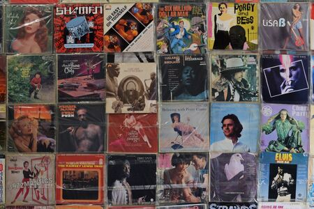 bod: ATHENS, GREECE - APRIL 24, 2015: Wall with old vinyl records vintage music lp album covers in plastic sleeves background. Editorial