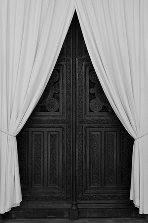 repairs: ATHENS, GREECE - APRIL 27, 2015: Antique wooden carved gate and drapes during repairs at the Metropolitan Cathedral of Athens, Greece. Black and white. Editorial