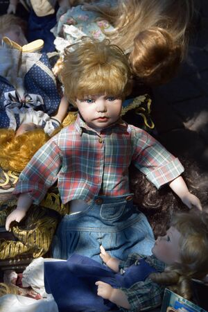 old toys: ATHENS, GREECE - MAY 31, 2015: Antique boy and girl dolls old toys for sale at flea market. Editorial