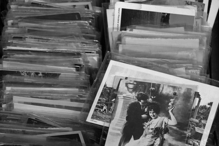 ATHENS, GREECE - MAY 21, 2015: Old photos and vintage postcard prints for sale at flea market. Black and white. Editoriali