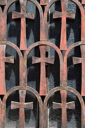 church window: Vintage cross pattern rusty metal motif on church window. Abstract background.