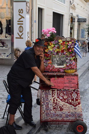 wheel barrel: ATHENS, GREECE - JUNE 12, 2015: Man playing traditional laterna portable barrel piano. Street musician in downtown Athens, Greece.