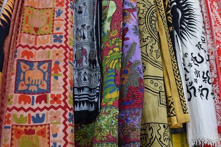illustrative material: ATHENS, GREECE - MAY 31, 2015: Textiles and shawls from India. Colorful fabric with traditional symbols and patterns. Editorial