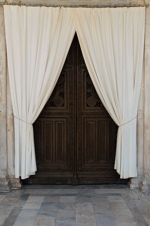 wood carving door: Wooden carved church gate and drapes. Metropolitan cathedral of Athens, Greece.